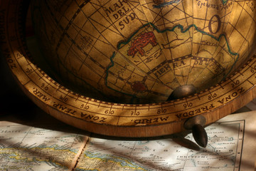 Antique globe on  maps