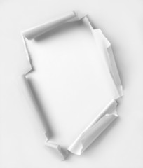 Hole ripped paper. Clipping path inside