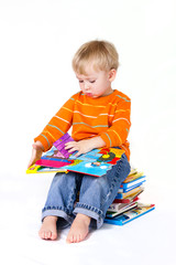 2 years old baby boy reading pop-up books.
