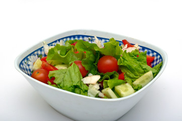 Vegetable salad from cucumbers, pepper, tomatoes, onions