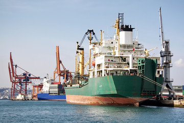 Trading port with cargo ships and cranes