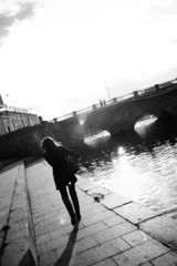 photo of the view to a bridge in city with girl walking