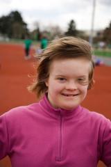 Jeune fille trisomique au stade