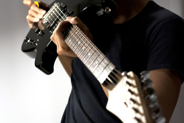 electriic guitar and the player