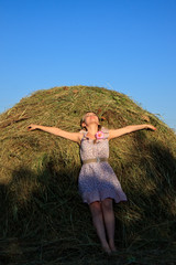 girl on a haystack