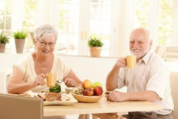 Senior couple having tea at breakfast