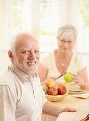 Portrait of older man at kitchen table