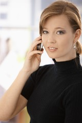 Portrait of young woman talking on mobile
