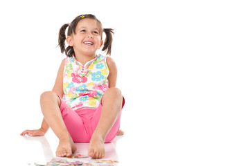 Smiling happy little girl sit