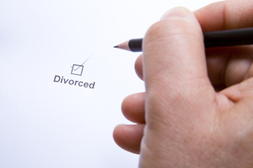 Man signing divorce documents