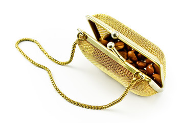 Golden metallic purse with coffee beans