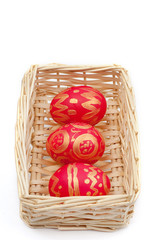 Easter eggs in a straw basket.