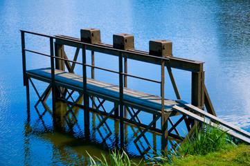 Pier, pond in the town Telc, Czech republic