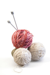 Spokes and color balls from wool on a white background