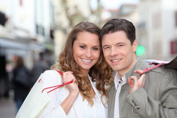 Couple holding shopping bags in town