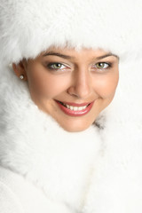 Close-up portrait of a beautiful woman in fur cap