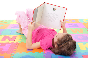 Girl child reading book