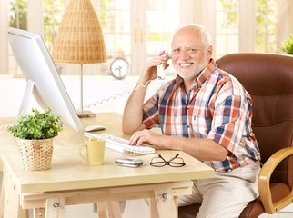 Happy old man on landline call