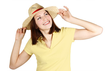 young girl in yellow shirt and straw hat smiling and looking at
