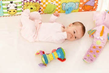 Baby girl looking at colorful toy