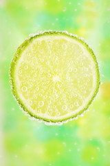 Close-up of a lemon  with bubbles