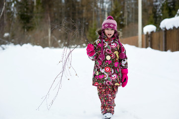 Winter portrait of beauty little girl in colorful clothes