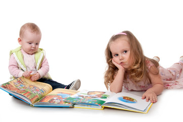 two babe with the children's book