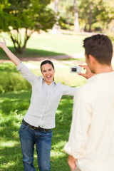 Man taking a photo of his girlfriend