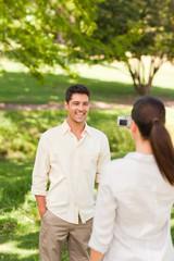 Woman taking a photo of her boyfriend