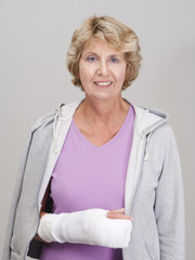 Elderly woman with arm in cast