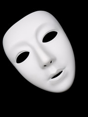 White theater mask isolated on black