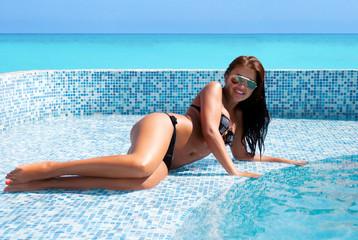 Happy girl relaxing in pool