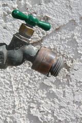 Water Spigot - Faucet - Spout against stucco wall