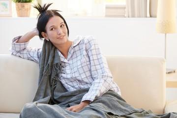 Morning portrait of pyjama girl with blanket