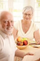 Happy senior woman having breakfast