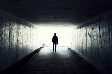 Acrylic Prints Tunnel Silhouette of Man Walking in Tunnel. Light at End of Tunnel