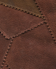 close-up of stitched together pieces of suede