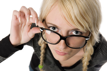 Pretty young woman with glasses looks like as nerdy girl, humor