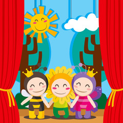 Babies on costumes performing on cute theater stage