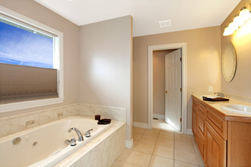 Large new bathroom with grey walls and large tub