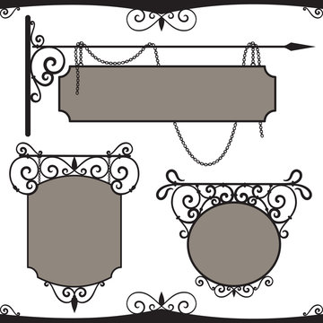 Vintage wrought iron signs.