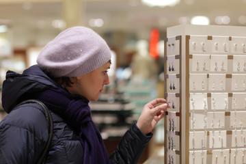 Woman chooses earrings