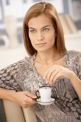 Portrait of beautiful woman having coffee