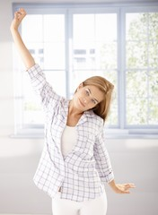 Young girl stretching in the morning in pyjama