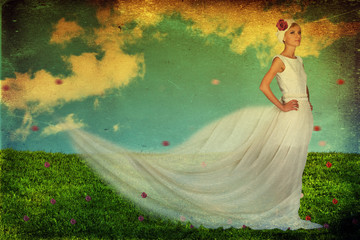 beauty young woman in white dress on the green meadow