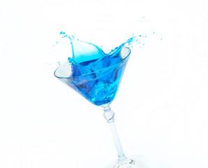 Blue splash in a glass