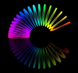 Multicolored slinky isolated on black background