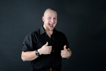 Happy man showing thumbs up