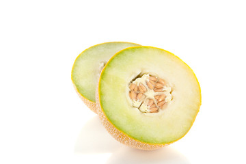 two cut half pieces of melon isolated over white background