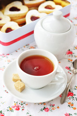 Tea and heart-shaped cookies in a tin box